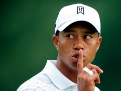 Tiger Woods of the United States gestures to a fan to be quiet from the fifth green during first round play at the WGC Bridgestone Invitational golf tournament in Akron, Ohio August 6, 2009. REUTERS/Aaron Josefczyk (UNITED STATES SPORT GOLF) - RTR26GXI